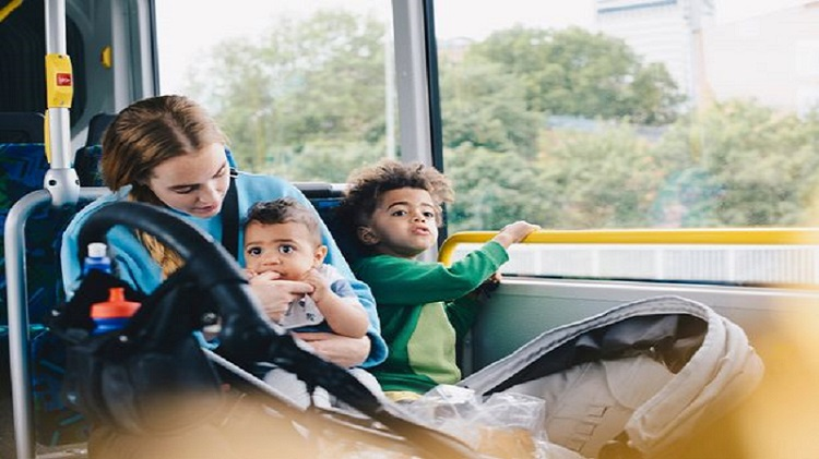 Mother-sitting-with-sons-in-bus